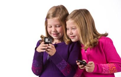 Beautiful twin girls text messaging